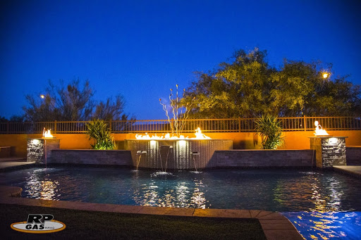 backyard pool with features